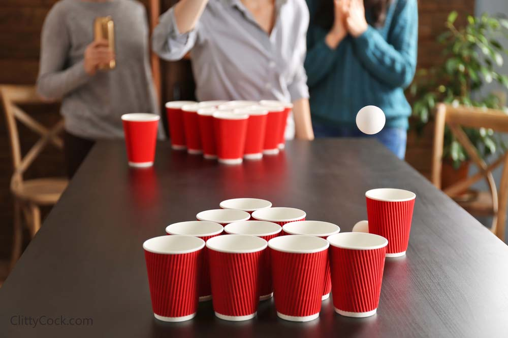 Playing beer pong.