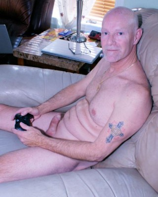 A guy gets busted with his clit cock showing while playing video games.