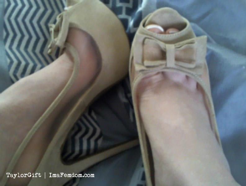 Pretty feet in peep toe shoes.
