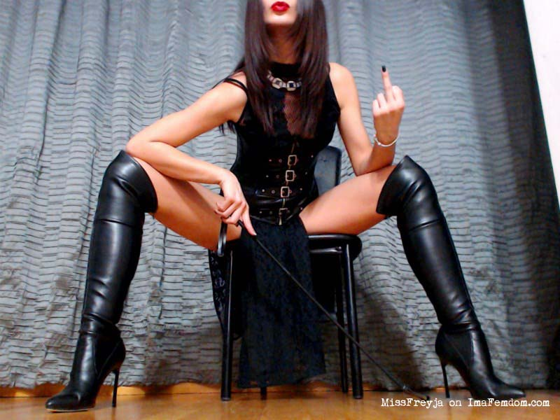 Tiny dick dominatrix giving the middle finger